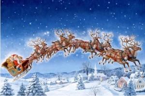 Père Noël dans son traineau tirés par les rennes.