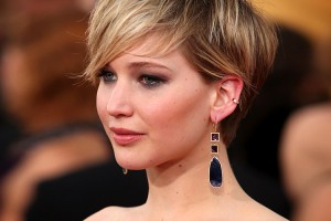 Jennifer Lawrence arrives at the 20th annual Screen Actors Guild Awards at the Shrine Auditorium on Saturday, Jan. 18, 2014, in Los Angeles. (Photo by Paul A. Hebert/Invision/AP)